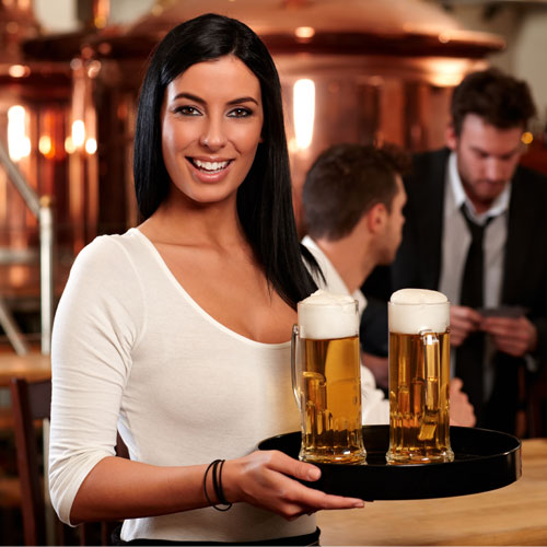 Young Woman Serving Beer in Bar
